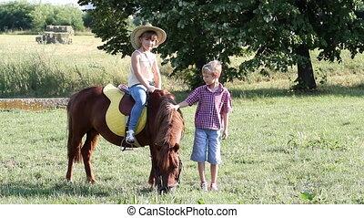 children with pony horse