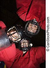 Women hockey player huddle. - Low angle of female hockey...