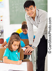 elementary school teacher - smiling elementary school male...