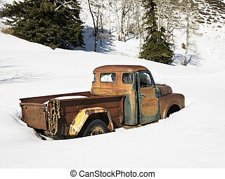 Old rusted truck. - Old rusted classic truck in snow covered...