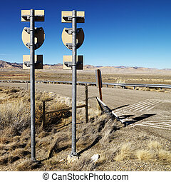 Two road signs - Two road signs on a psot with guardrail and...