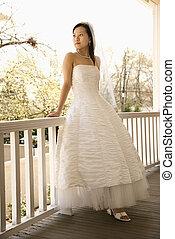 Bridal portrait. - Portrait of an Asian bride leaning...