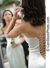 Back of woman in evenging gown.