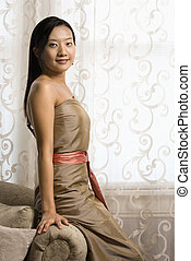 Bridesmaid portrait. - Portrait of an Asian woman in a...