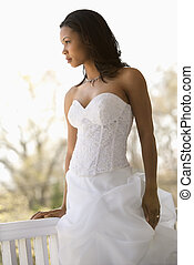 Bridal portrait - Portrait of African-American bride leaning...