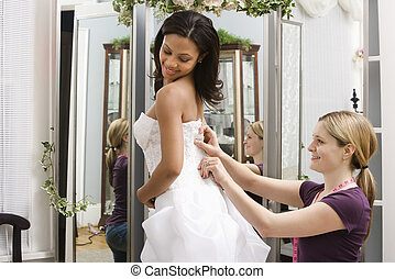 Seamstress helping bride. - Caucasian seamstress helping...