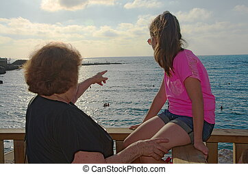Grandmother and granddaughter admiring the view at the...