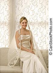 Bridal portrait. - Portrait of Caucasian bride sitting on...