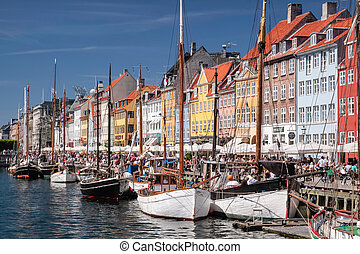 Old boats and houses in Nyhavn in Copenhagen - Old boats and...