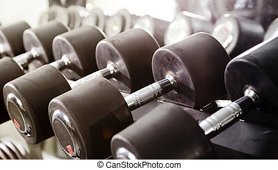 Dumbbells - Close up of a rack of dumbbells in a gym.