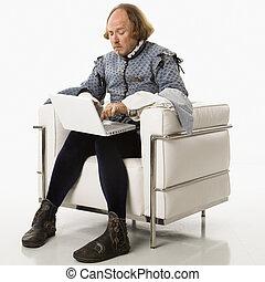 Shakespeare on laptop computer. - William Shakespeare in...