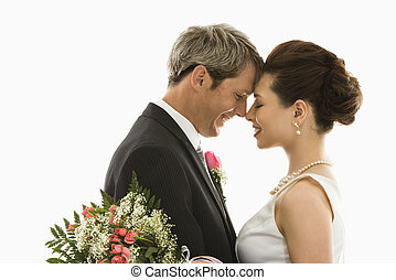 Bride and groom - Portrait of Caucasian groom and Asian...