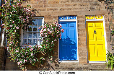 Colorful cottages with climbing roses - Terraced cottages...