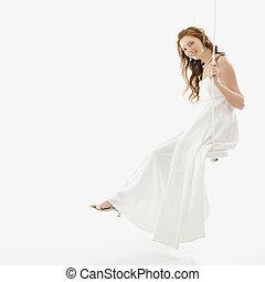 Bride on swing set. - Portrait of Caucasian bride swinging...