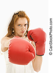 Bride with boxing gloves. - Caucasian bride with boxing...