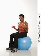 Woman exercising with ball.