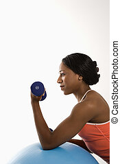 Profile woman lifting dumbbell - Profile of African American...