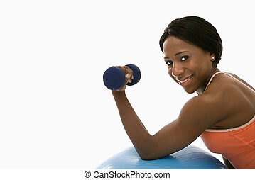 Woman lifting dumbbell. - African American young adult woman...