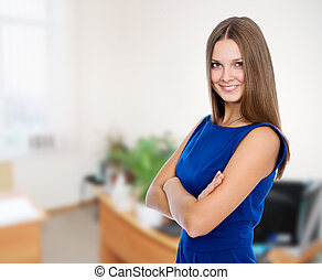 Portrait of a beautiful happy business woman in a blue dress
