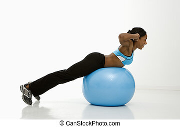 Profile of woman exercising - Profile of African American...