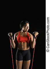 Woman stretching resistance tube.