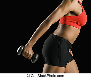 Woman exercising with dumbbell - Side view if torso of...