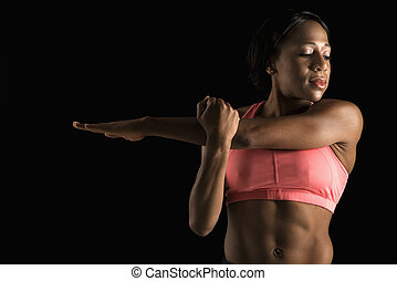 Woman stretching arm.
