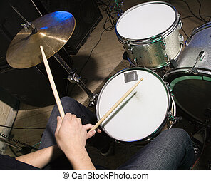Drummer playing drumset. - Above view of drummer\'s hands...