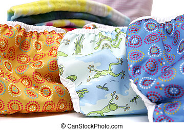 cloth diapers up close - three colorful cloth natural...