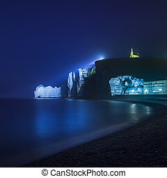 Etretat cliff and church landmark and its beach. Night photography. Normandy, France.