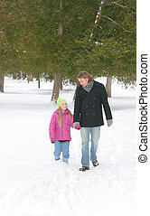 bro and sis in winter - one young brother and sister walking...