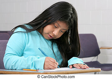 student girl - one young girl student writing in a classroom