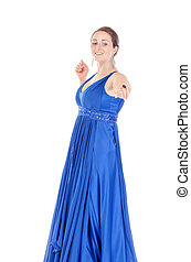 Portrait of a beautiful young woman in blue dress, holds out his hand on white background