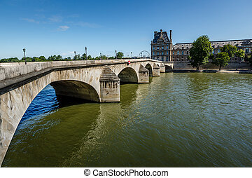 View of Louvre Palace and Pont Royal in Paris, France