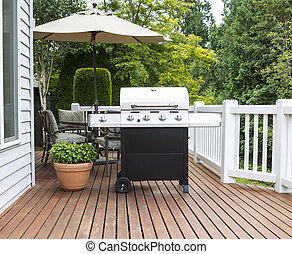 Large barbecue cooker on cedar deck - Photo of large...