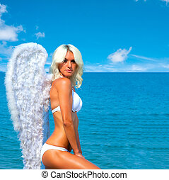Angel Girl - Beautiful sexy blonde woman with angel wings on...