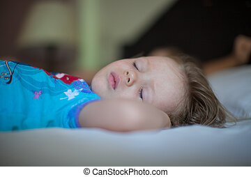Adorable toddler taking a nap