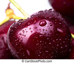 Sweet cherry macro background with water drops