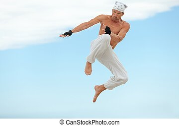 man is jumping sport karate martial arts fight kick jump...