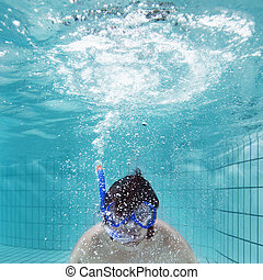 Exhaling underwater - Man, wearing driving glasses and a...