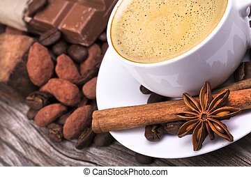 coffee with Chocolate bar and spices - white cup of espresso...