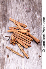 Different spices, Cinnamon, anise on wooden table -...