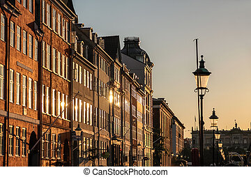Facades in the evening light at Nyhavn in Copenhagen,...