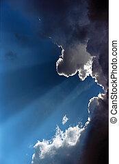 sun lit clouds