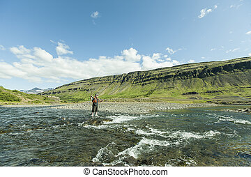 Flyfisherman with a catch