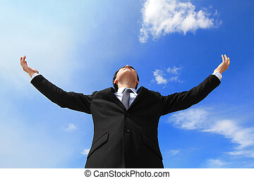 Business man carefree outstretched arms with sky and cloud,...
