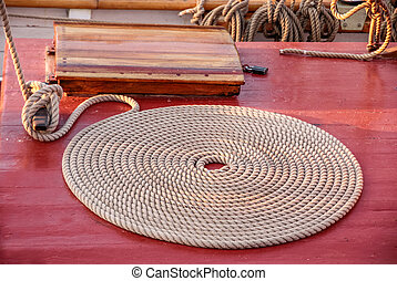 Coiled rope on the deck of an old sailing ship in Nyhavn in...