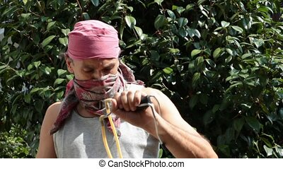 masked slinger - masked man with sling