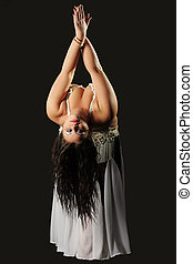 Belly dancer girl photo over dark background