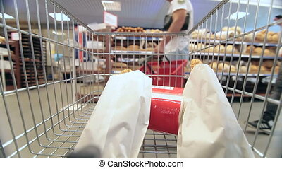 Supermarket Shopping   - Moving shopping cart in supermarket